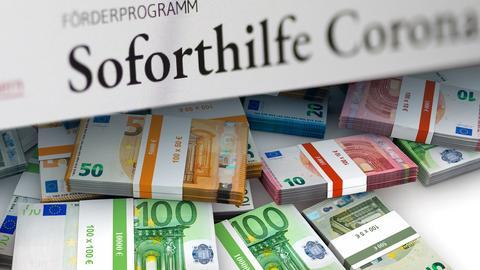 Corona-Soforthilfe Formular mit vielen Geldbündeln