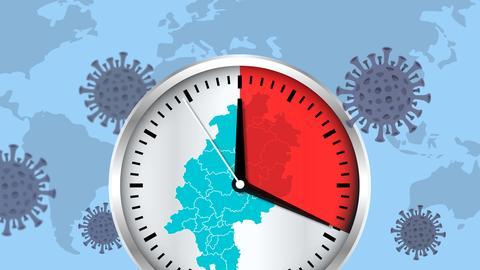 Auf einer Uhr sind neunzehn Minuten angezeigt: die Zeit, wie oft in Hessen jemand an oder mit Corona stirbt.