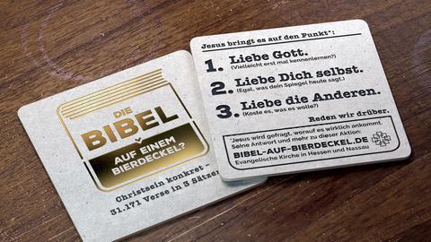 Die ganze Bibel auf einem Bierdeckel EKHN-Aktion