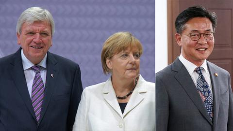 Gäste des Festakts: Hessens Ministerpräsident Volker Bouffier, Bundeskanzlerin Angela Merkel (beide CDU) und der südkoreanische Vereinigungsminister Hong Yong-Pyo (v.l).