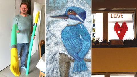 """""""Eine 1,5 Meter lange """"Corona-Hand"""", ein Gemälde eines Eisvogels, eine Fensterscheibe mit einem aufgeklebten Herz"""