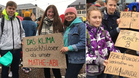 Schüler halten Transparente für Klimaschutz.