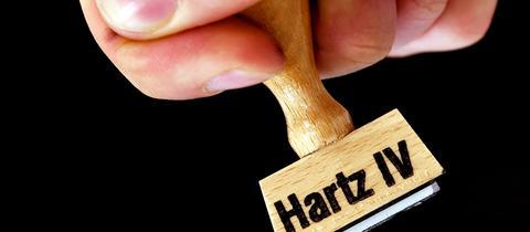 """Stempel mit Aufdruck """"Hartz IV"""""""