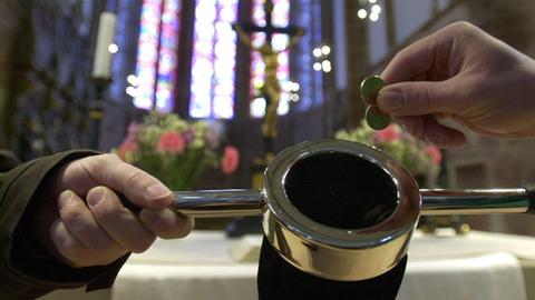 Klingelbeutel in Kirche
