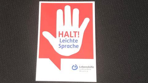 Rote Karte der Lebenshilfe Hessen zur Benutzung der leichten Sprache