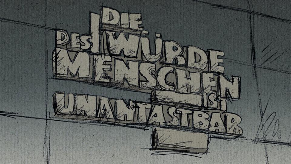 """Zeichnung des Zitats """"Die Würde des Menschen ist unantastbar"""" an der Außenwand des Gerichts."""