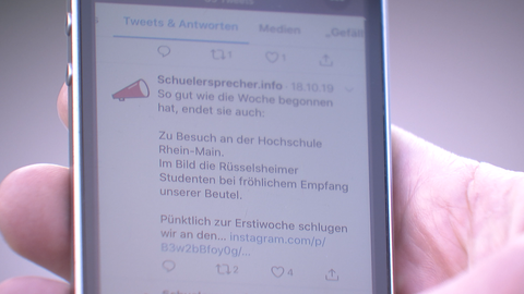 Handy mit schuelersprecher.org-Tweets