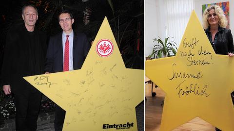 """Ottmar Hörl, der die Skulptur entworfen hat mit Cord Gebhardt von der Deutschen Börse, der den Eintracht-Stern ersteigert hat. Susanne Fröhlich mit ihrem Stern und der Aufschrift """"Greift nach den Sternen!"""""""