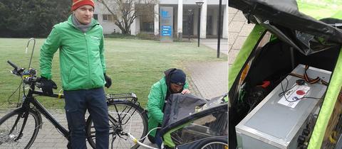 Das Messgerät steckt in Fahrradanhänger:  Tobias Riedl (links) von Greenpeace zeichnete Stickoxid-Belastung in Frankfurt auf