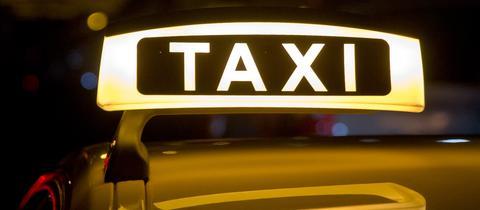 Leuchtendes Taxischild