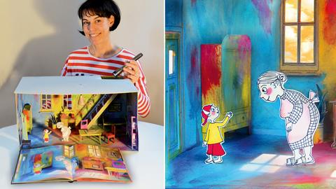 """Autorin und Grafikerin Antje Damm beleuchtet mit Taschenlampe ihr Pappmodell-Motiv für das Buch """"Der Besuch"""""""