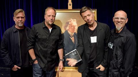 Die Fantastischen Vier posieren mit dem Jacob-Grimm-Preis