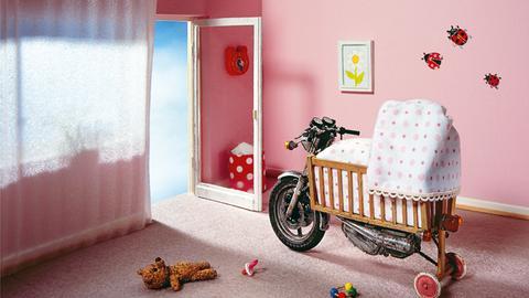 Kinderwiege auf Motorrad