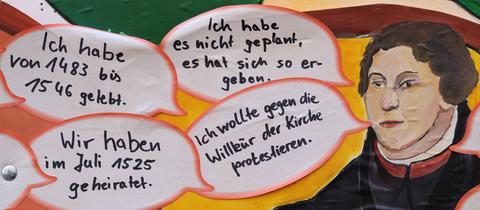 Gezeichneter Luther mit Sprechblasen und Sätzen, die er gesagt haben könnte