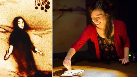 Anne Löper streut mit Wüstensand ein Bild auf einen Lichttisch