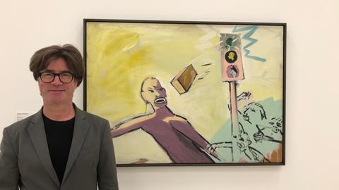 """Der Leiter der Sammlung Gegenwartskunst im Städel, Martin Engler, steht vor Georg Herolds  """"Ziegeln_ _ _ r """""""