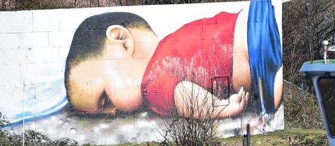 Aylan-Gemälde beschmiert