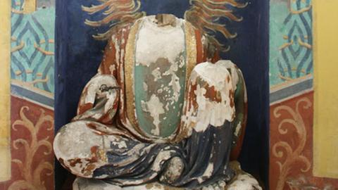 Buddha ohne Kopf und Hände