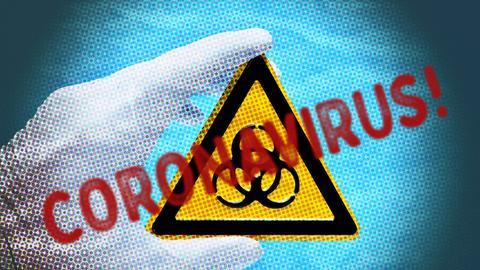Der Schriftzug Coronavirus vor einem Biogefährdungswarnschild