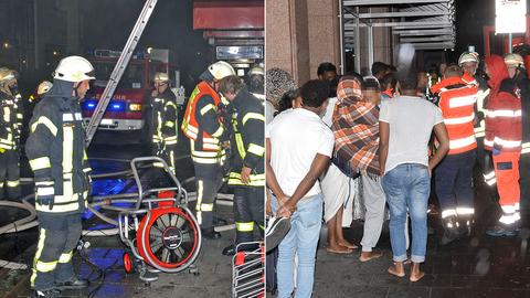 Feuerwehrmänner und Bewohner auf der Straße in Limburg