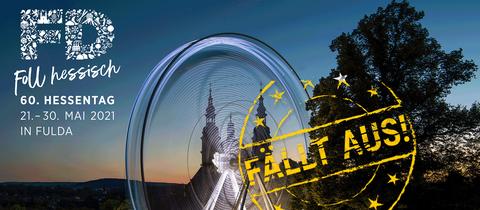 """Das Foto zeigt Fulda bei Nacht mit dem Logo des Hessentages 2021 und einem Stempel mit den Worten """"Fällt aus!""""."""