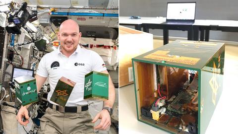 Raumfahrer in Kapsel (ISS) mit elektronischem Kasten
