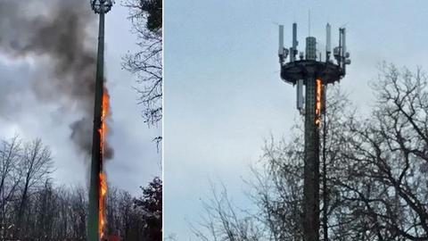 Die Verkabelung entlang des 50 Meter hohen Mobilfunkmasts steht in Flammen.