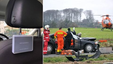 Notfallbox an Kopfstütze, Rettungskräfte bei Autounfall