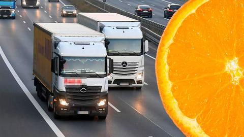 Zwei Lkw und eine Orange