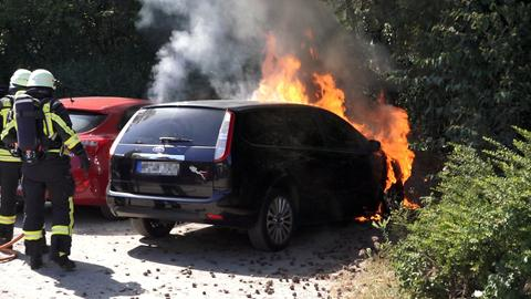 Two burning cars and firemen