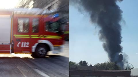 Feuerwehr und Rauchsäule.
