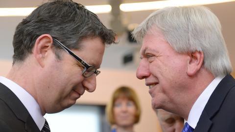 SPD-Landesvorsitzenden Thorsten Schäfer-Gümbel (links), Ministerpräsident Volker Bouffier (CDU)