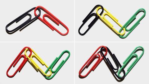 Büroklammern in unterschiedlichen Farben symbolisieren verschiedene Koalitionen.