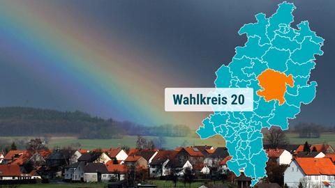 Die Ortschaft Crainfeld bei Grebenhain im Vogelsberg unter einem Regenbogen.