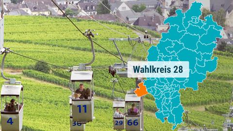 Das Bild zeigt Gondeln, die von Rüdesheim zum Niederwalddenkmal schweben.