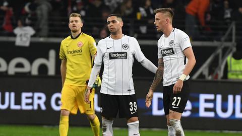 Lukas Hradecky, Omar Mascarell und Marius Wolf
