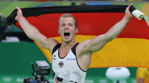 Fabian Hambüchen bejubelt Olympia-Gold