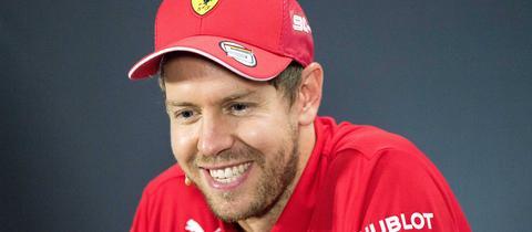 Sebastian Vettel lacht