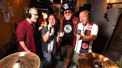 Vier Musiker beim singen