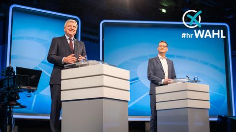 Das Foto zeigt die Spitzenkandidaten Bouffier und Schäfer-Gümbel im Fernsehstudio