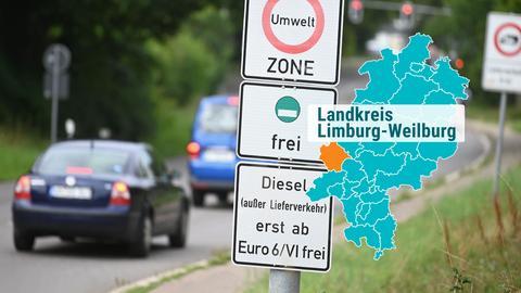 Autos fahren an Schildern Umweltzone und Dieselfahrverbot vorbei