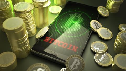 Bitcoin-Münzen und ein Handy