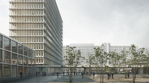 Das alte Bundesbankgebäude im Hintergrund mit einem der drei neuen Bürogebäude
